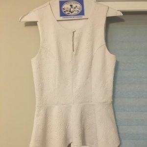 White Peplum Sleeveless Shirt